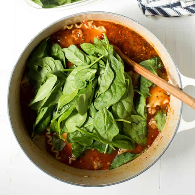 spinach in a large pot of lasagna soup