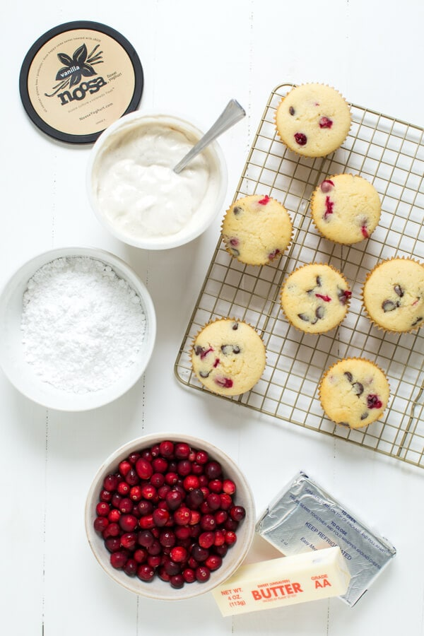 Vanilla bean cupcakes with fresh cranberries and chocolate chips are topped with vanilla bean yoghurt frosting!