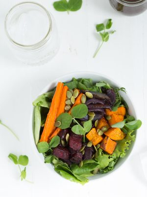 Roasted Winter Vegetable Salad with Maple Balsamic Dressing is an easy side salad or entrée made with thyme roasted vegetables and homemade maple balsamic dressing!