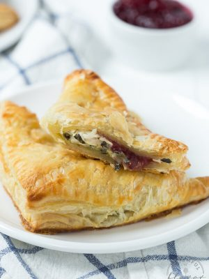 Turkey cranberry spinach and artichoke turnovers are an easy appetizer or snack made with leftover turkey, cranberry sauce and spinach and artichoke dip!
