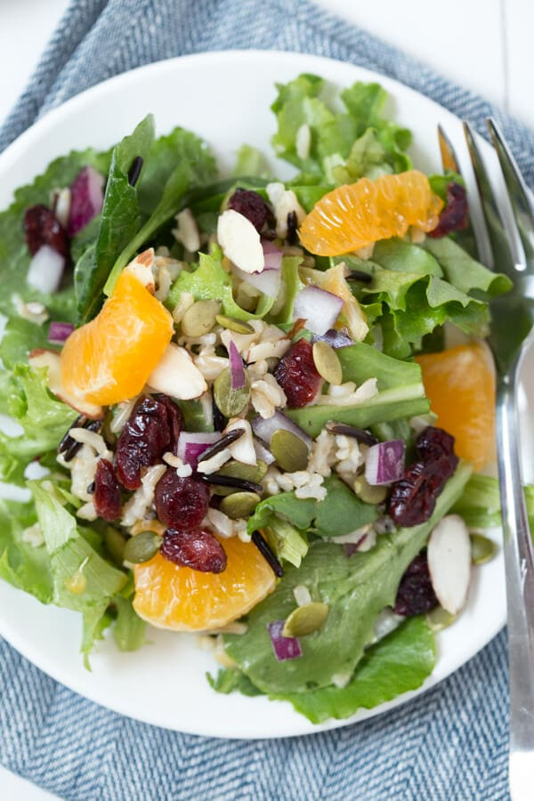 Winter Harvest Salad with Wild Rice, Dried Cranberries, Citrus and more! A light, refreshing and nutritious salad that is a great addition to your lunch or dinner menu.