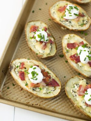 Prep for the big game with these Loaded Potato Skins with Spinach Artichoke and Parmesan Dip!