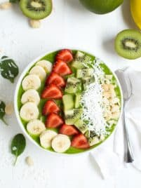 Tropical Green Smoothie Bowl is made with only a few delicious ingredients including pineapple, banana, mango, spinach and more!