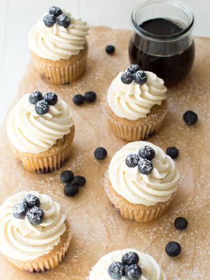 Blueberry French Toast Cupcakes are irresistible! A cinnamon maple cake is topped with maple buttercream frosting and fresh blueberries.