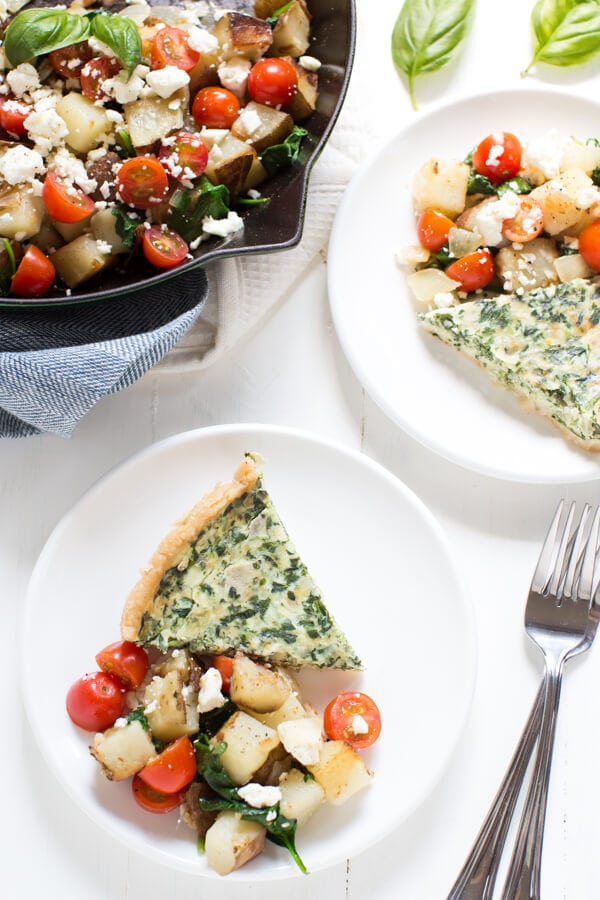 Homemade breakfast potatoes with spinach, tomatoes and feta pair well with quiche and create an easy yet impressive meal that is ready in less than 30 minutes!