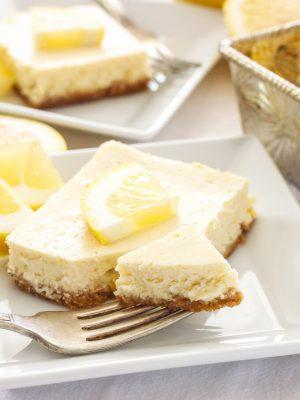 Greek Yogurt Lemon Cheesecake Bars | Lightened up, creamy and bursting with fresh lemon flavor, these Greek Yogurt Lemon Cheesecake Bars are the perfect dessert to make this spring!