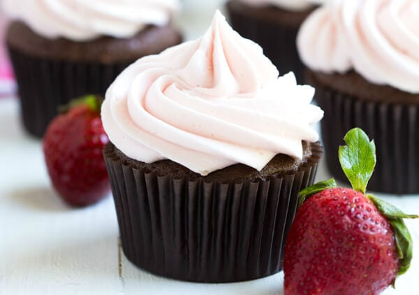Chocolate Cupcakes with Strawberry Marshmallow Frosting are a classic recipe that everyone will love! Made with fresh strawberries!