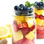 Mason Jar Fruit Salad with Strawberry Mint Dressing is made with the freshest flavors piled high in a mason jar. Kids and adults will love it!