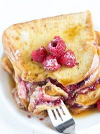 Raspberry Cheesecake Stuffed Brioche French Toast is a great idea for breakfast or brunch. With sweet raspberry amaretto preserves and cheesecake filling, this buttery french toast is too good to resist!