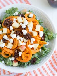 Spiralized Sweet Potato and Kale Salad is made with a few simple ingredients and comes together in little time! Serve with homemade maple balsamic dressing.