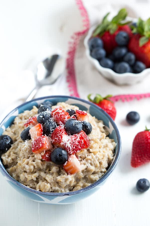 Creamy Coconut Oatmeal with fresh berries from Heather Christo's new cookbook Pure Delicious!