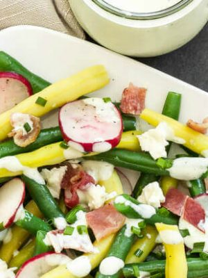 Green Bean, Radish and Bacon Salad with Creamy Feta Dressing | Fresh green beans and radishes mixed with bacon and topped with an amazing feta dressing! The perfect summer salad!