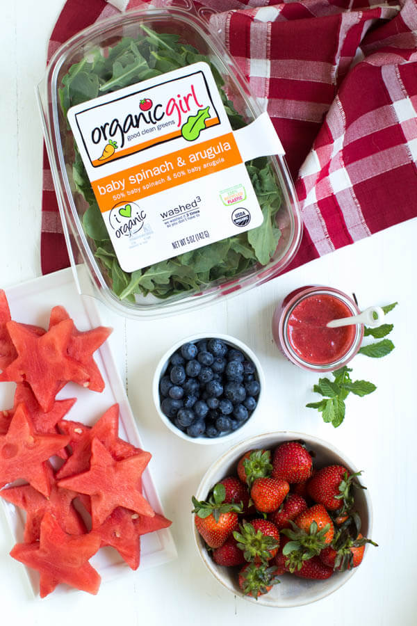 Watermelon Berry Salad is a refreshing summer salad made with fresh watermelon, strawberries, blueberries, greens and homemade strawberry dressing!