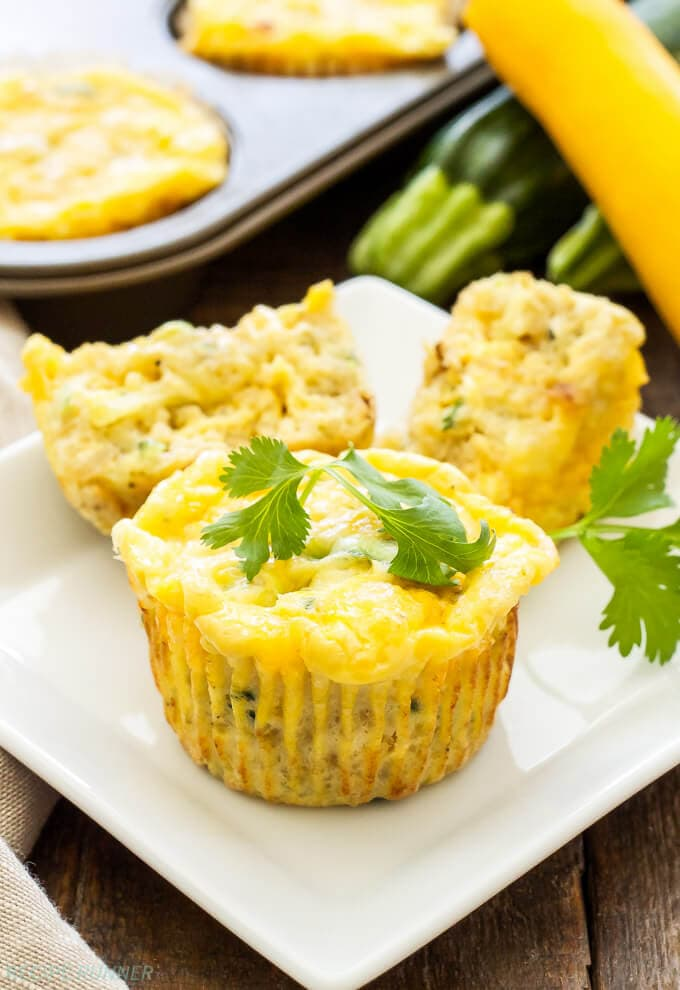 Cheesy Zucchini Quinoa Egg Muffins | Skip the drive-thru egg muffins and make these healthy, freezer friendly, Cheesy Zucchini Quinoa Egg Muffins! Full of protein and carbs they're the perfect way to start the day!