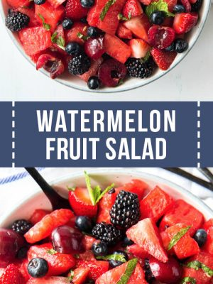 A large bowl of fruit salad with watermelon, berries, cherries and mint.