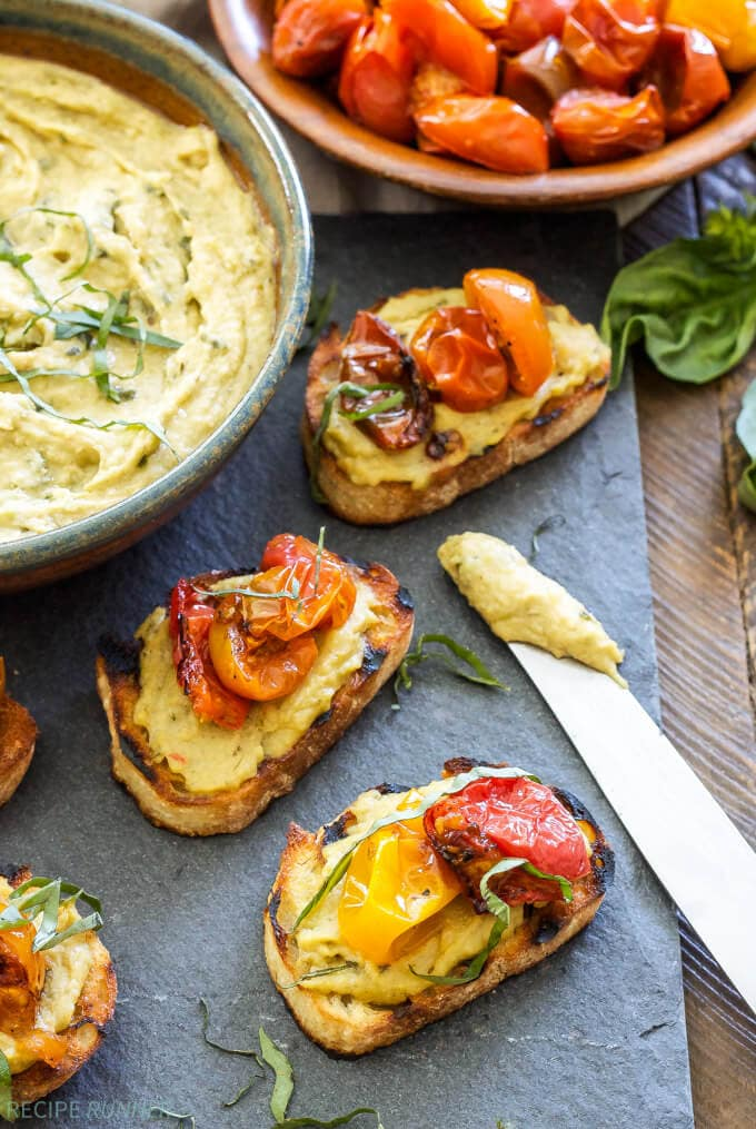 Basil Pesto Hummus and Roasted Tomato Crostini | www.reciperunner.com