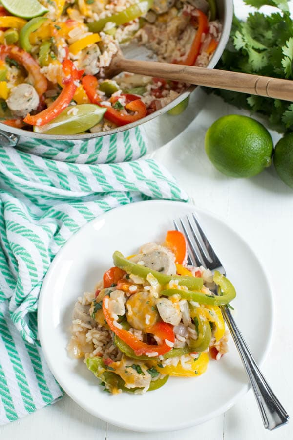 Skillet Fajita Chicken Sausage and Rice is made in one skillet and comes together in little time. Fresh bell peppers, onions, chicken sausage, fajita seasoning and rice are combined to create a meal for the entire family!