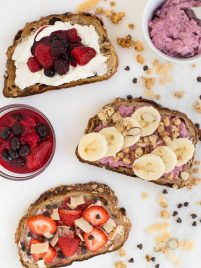 Berry Breakfast Toast adds beautiful color and delicious flavor to your morning -made with frozen berries, fresh fruit, granola, chocolate chips, cream cheese and more!