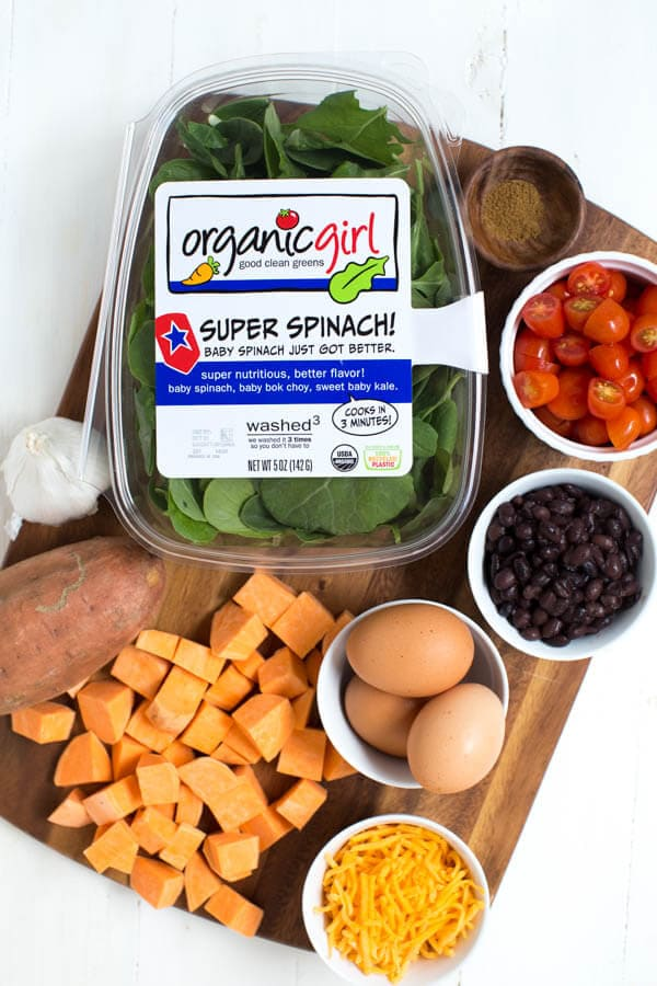 Sautéed Sweet Potato and Greens Breakfast Bowl is made with sweet potato, fresh greens, black beans, tomatoes, cheese, egg and avocado! This simple and healthy meal is perfect for any day of the week.