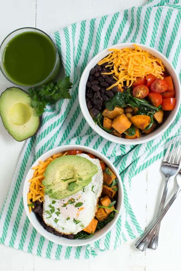 Sauteed Sweet Potato and Greens Breakfast Bowl is made with sweet potato, fresh greens, black beans, tomatoes, cheese, egg and avocado! This simple and healthy meal is perfect for any day of the week.