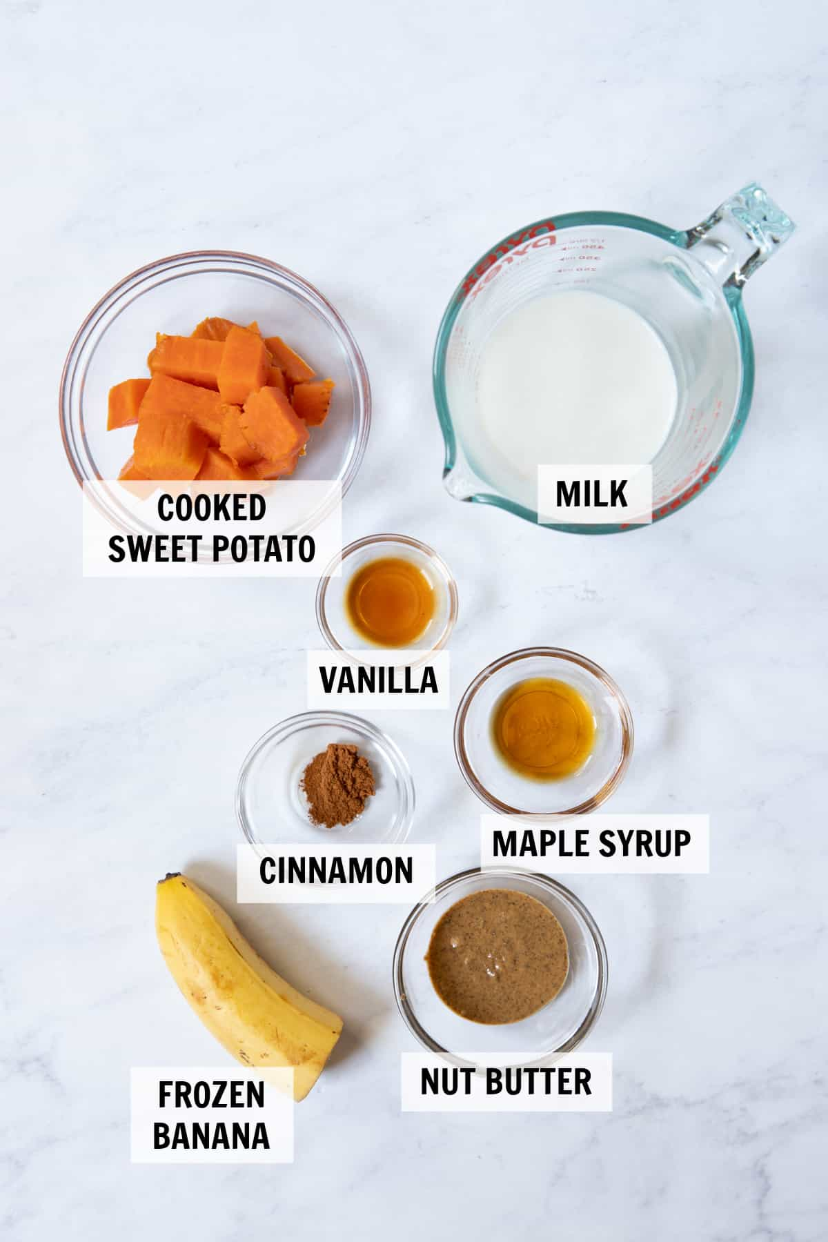 all of the ingredients for a smoothie on a tabletop