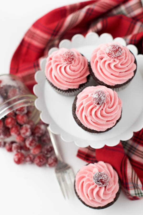 Gingerbread cupcakes with cranberry buttercream frosting combine two of your favorite holiday flavors in one sweet treat that is sure to impress!