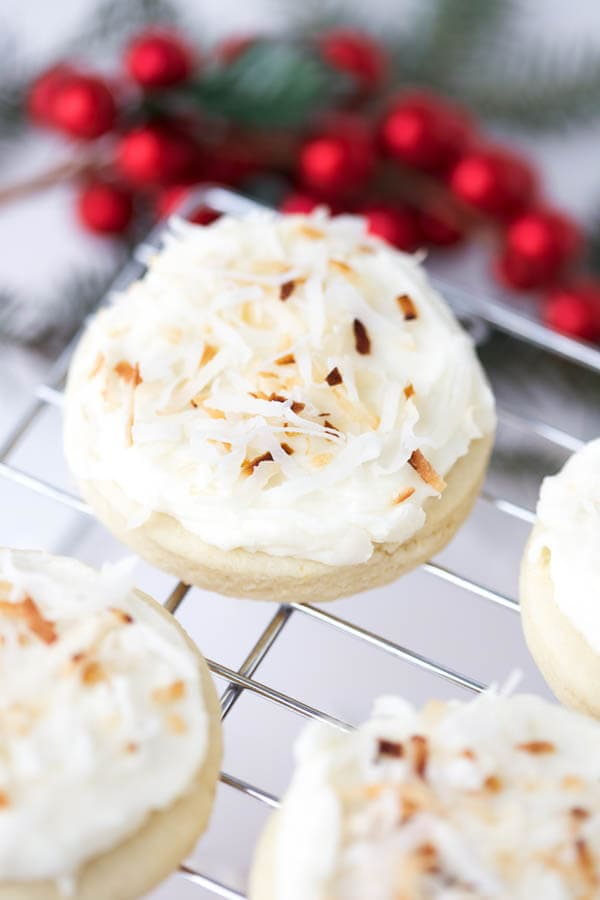 Toasted Coconut Soft Sugar Cookies combine everything you love about your favorite store-bought sugar cookie with homemade buttercream frosting and toasted coconut!