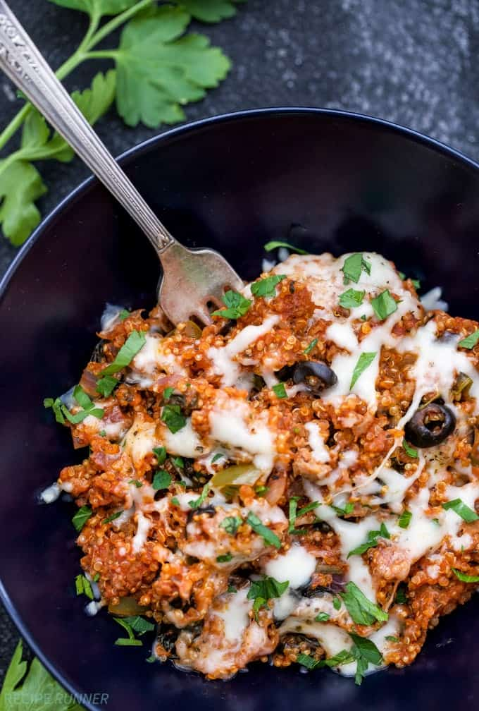One Pot Supreme Pizza Quinoa Casserole is a great way to get your pizza fix, but in a healthier and more wholesome way. You'll love how easy and how quick this one pot meal is to make! | www.reciperunner.com