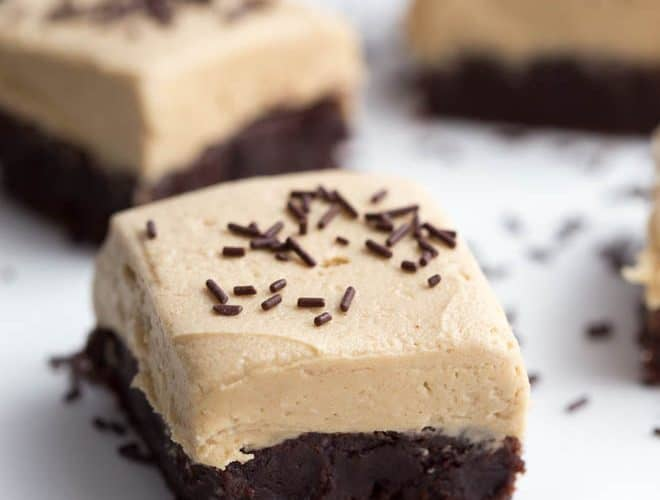 Flourless Brownies with Peanut Butter Frosting are easy to make and irresistible! A fudgy brownie is topped with whipped peanut butter buttercream frosting to create a sweet treat that everyone will love.