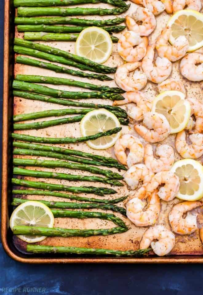 Sheet pan Lemon Roasted Shrimp and Asparagus with Herbed Couscous is one of the easiest dinners I've made and It's full of gourmet flavor! It can be on the table in 15 minutes or less!