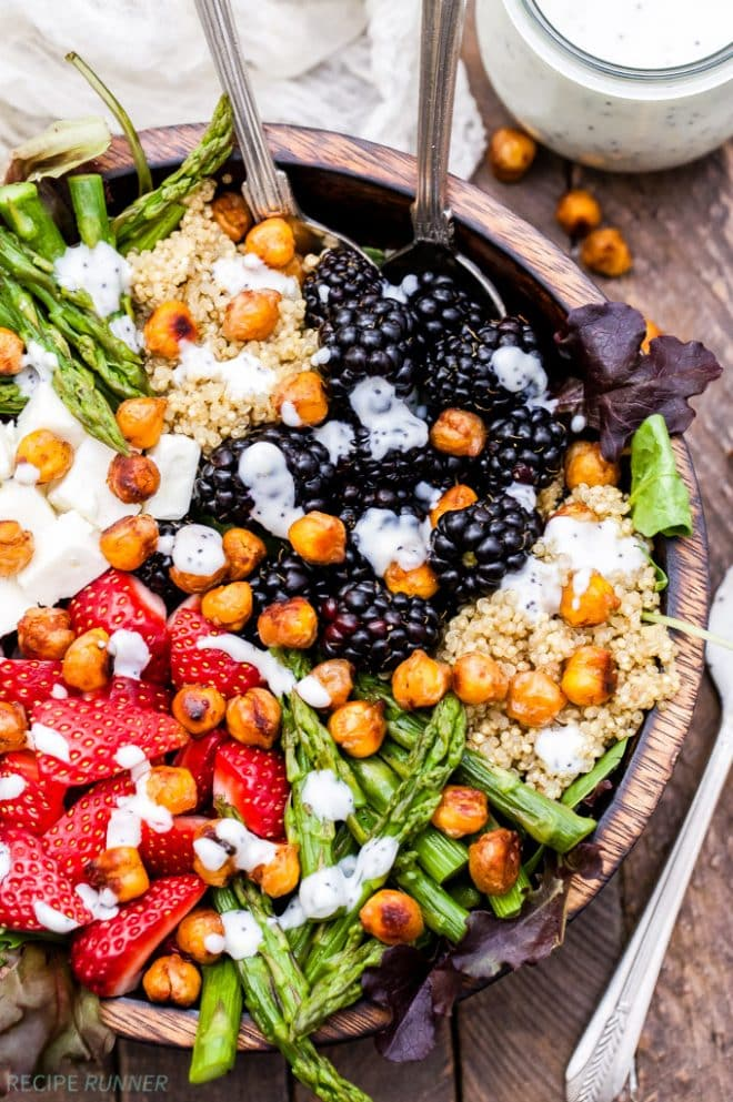 Berry, Asparagus, Quinoa and Feta Salad with Sweet Crispy Chickpeas is bursting with spring produce and topped with the most addicting sweet, crispy, maple cinnamon roasted chickpeas! It's perfect to make any day of the week and beautiful enough for company. www.reciperunner.com