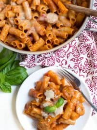 Chicken Rigatoni Pasta Skillet comes together in under 30 minutes and cooks in one pot to make clean up easy! Kids and adults will love this simple meal made with chicken sausage, rigatoni, pasta sauce, cheese and more.