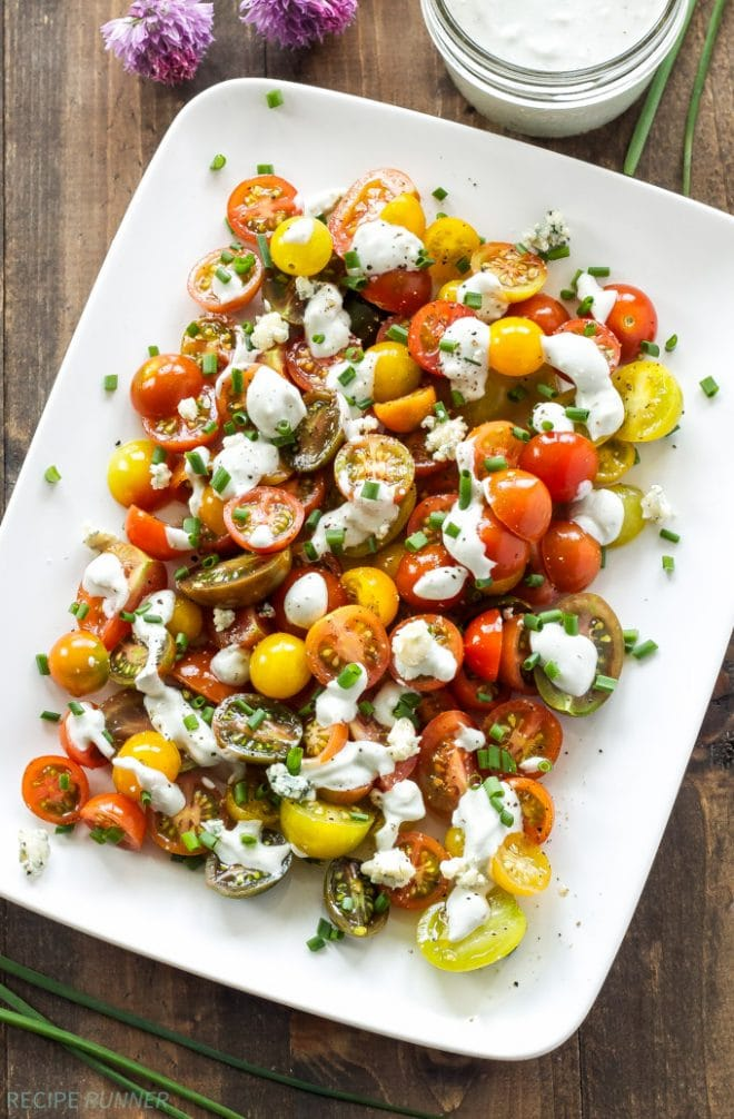 Sweet heirloom tomatoes topped with homemade creamy blue cheese dressing is the perfect, fresh summer salad! www.reciperunner.com