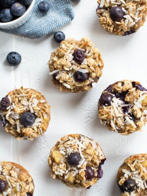 Banana Blueberry Coconut Baked Oatmeal Cups are a a great on-the-go breakfast or snack option! Made with coconut milk, maple syrup, bananas, blueberries, coconut and oats, these tasty little cups are a healthier option for both kids and adults.