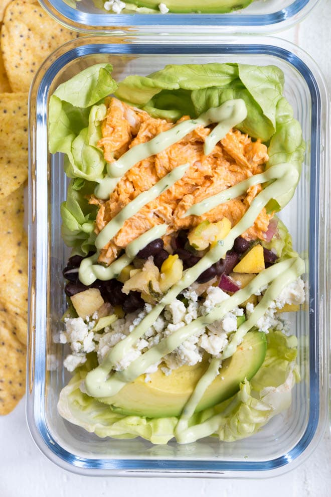 Pineapple Mango Buffalo Chicken Taco Bowls with Avocado Ranch Dressing are loaded with buffalo chicken, butter lettuce, mango pineapple and black bean salsa, blue cheese crumbles, avocado and topped with a creamy avocado ranch dressing!