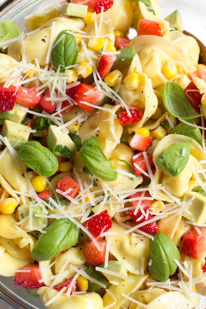 Strawberry, Corn and Avocado Tortellini Salad is a refreshing summer salad made with strawberries, corn, avocado, basil, Parmesan cheese and a simple balsamic dressing!