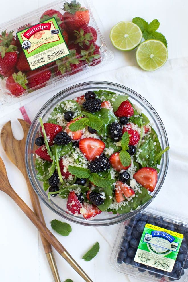 Triple Berry Couscous Salad combines couscous with fresh spinach, strawberries, blueberries and blackberries. Drizzle the homemade honey lime mint dressing over the salad to create a light and flavorful addition to any meal!