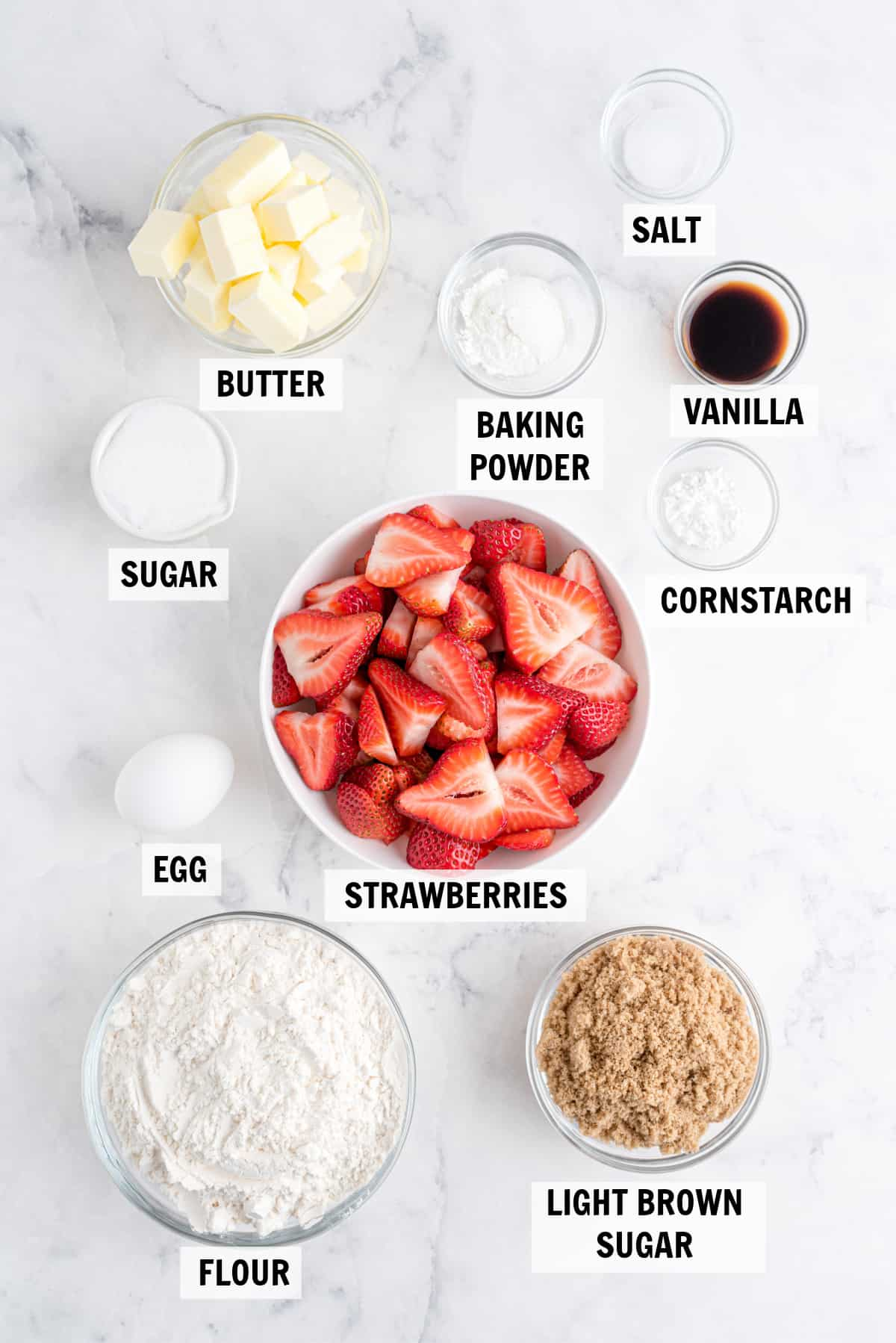 all of the ingredients for strawberry bars in bowls