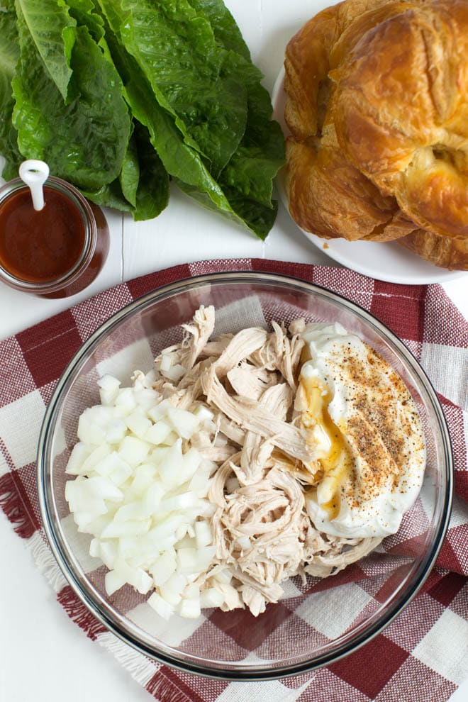 Light and Creamy Barbecue Chicken Salad is made with Greek yogurt, barbecue sauce, yellow onion and a few simple seasonings to create a chicken salad that you will want to eat all year long!