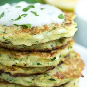 5-ingredient Parmesan Zucchini Fritters with lemon garlic yogurt sauce are a fun and easy appetizer that is made in less than 25 minutes!
