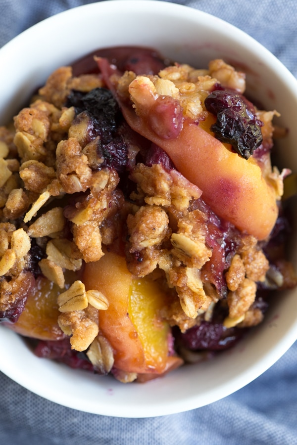 Grilled Peach and Blueberry Crisp is made with only a few simple ingredients including fresh peaches, wild blueberries and crisp oat topping! The fresh crisp is cooked on the grill so you don't even have to turn on the oven.