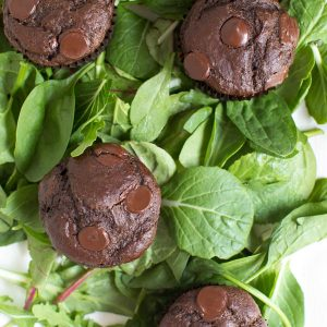 Superfood Double Chocolate Muffins are packed with leafy greens, banana, chocolate and Greek yogurt! You will never know that two heaping cups of greens are hidden in these chocolate muffins.