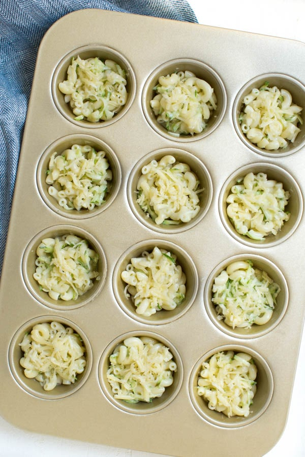 Zucchini Mac and Cheese Bites are a great way to pack fresh zucchini into a fun and delicious meal! Made with only a few ingredients, kids and adults will love these little mac and cheese bites.
