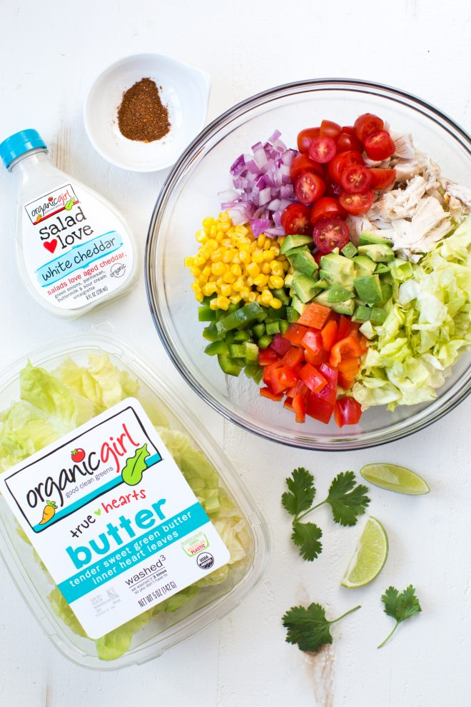 Creamy Chicken Fajita Chopped Salad comes together in less than 15 minutes! It is packed with fresh veggies, butter lettuce, creamy white cheddar dressing and fajita seasoning.