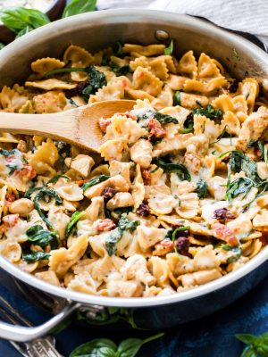 One Pot Creamy Sun Dried Tomato and Spinach Pasta with Chicken is an easy to make dinner the whole family will love! You won't believe there isn't a drop of cream in this flavorful, healthy pasta dish!