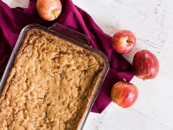 Caramel apple cake is baked in a 13x9 dish for plenty of servings! | www.ifyougiveablondeakitchen.com