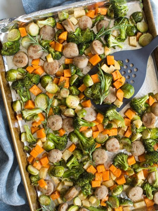 One pan chicken sausage with roasted vegetables and apples is an easy sheet pan meal that is made in less than 30 minutes! A few simple ingredients creates a flavorful fall meal.