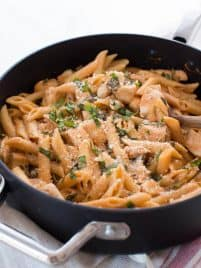 One Pot Creamy Tomato Pasta with Chicken and Spinach comes together in 35 minutes! The entire meal cooks in one pot and creates a dish that kids and adults love.