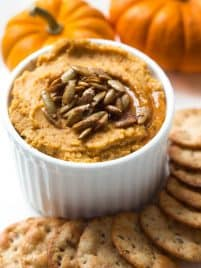 Cinnamon Spice Pumpkin Hummus is made with classic hummus ingredients plus pumpkin puree, maple syrup, cinnamon and nutmeg to create a savory fall snack!