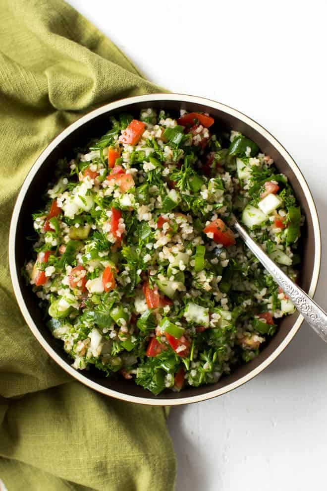 easy tabbouleh salad in a bowl with a fork in it
